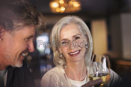 portrait smiling senior couple drinking white