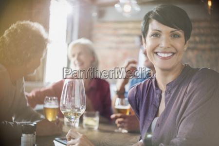 portrait smiling woman drinking white wine
