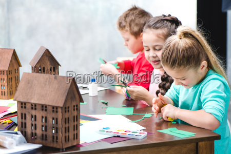 schoolchildren making applique