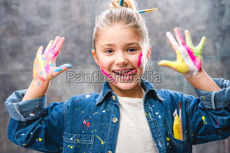 schoolgirl artist with painted face