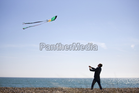 a young man flying a kite