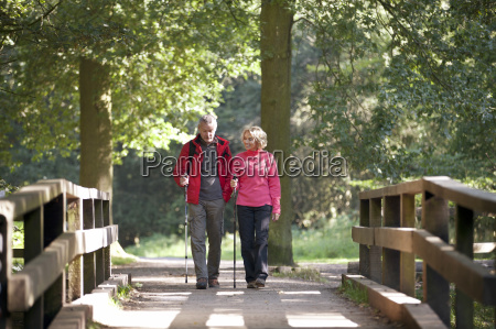a mature couple walking over a
