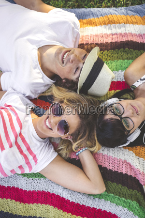 young woman with friends lying on