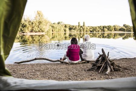 senior couple camping at a lake