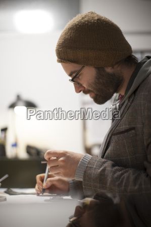 young man working in designer office