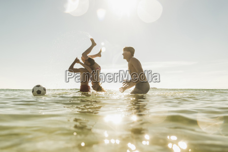 playful friends in the sea