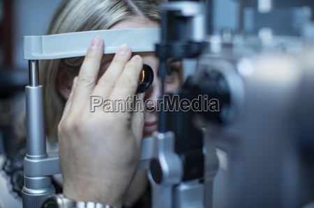 mature woman doing eye test at
