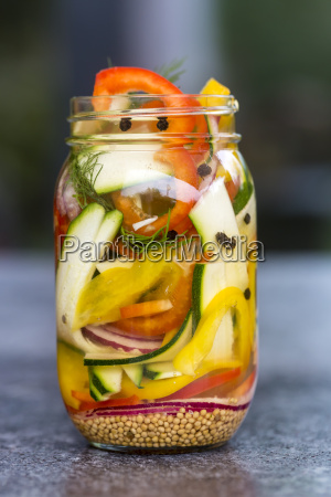 pickeled vegetables and herbs in preserving