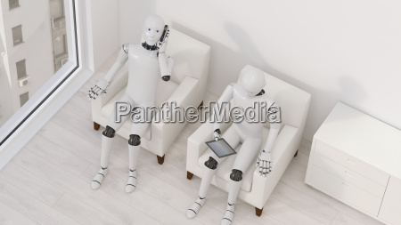 two robots sitting on armchairs with