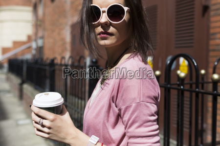 fashionable young woman with coffee to