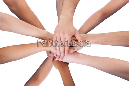 group of cleaners stacking hands