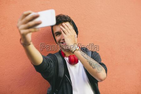 teenager smiling selfie smartphone