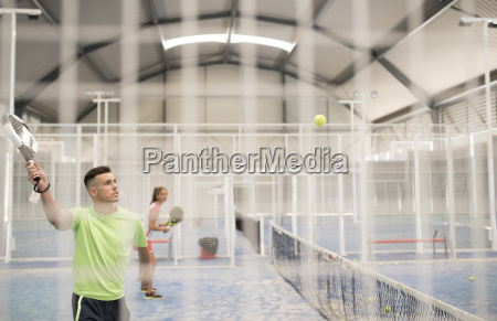 two paddle tennis players on court