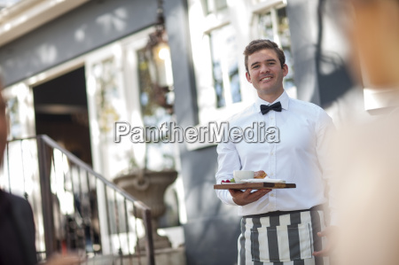waiter serving at outdoor restaraunt
