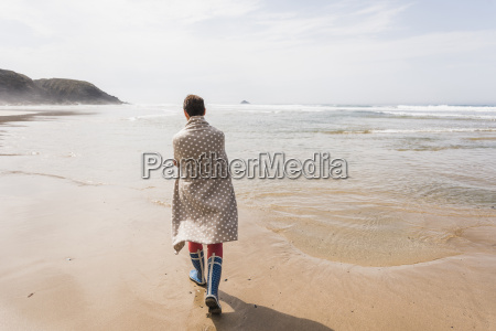 mature woman walking on the beach