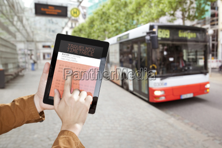 hand holding a digital tablet with