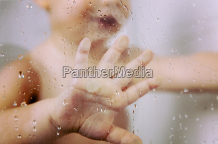 hand of little boy against wet
