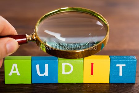 person with magnifying glass over the