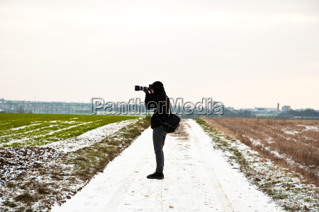 boys taking pictures of acres with