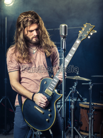guitarist rocking on stage