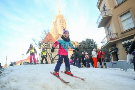 girl skiing in city center