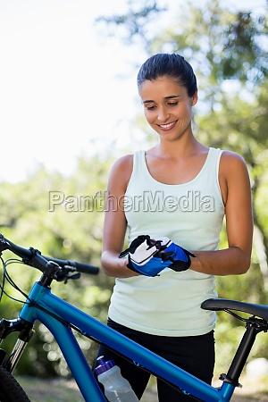 woman smiling and preparing ride bike