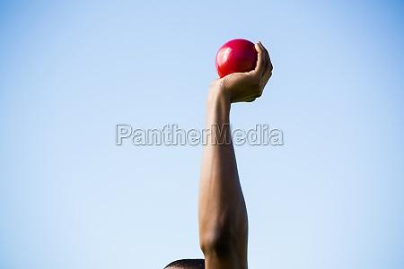 athletes hand performing shot put