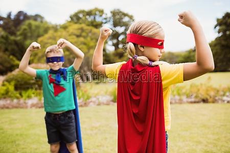 children wearing superhero costume posing for