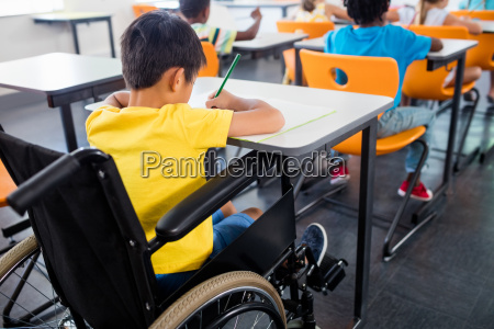 a pupil in wheel chair working