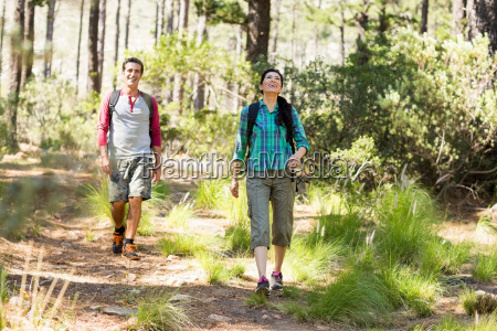 couple smiling and hiking