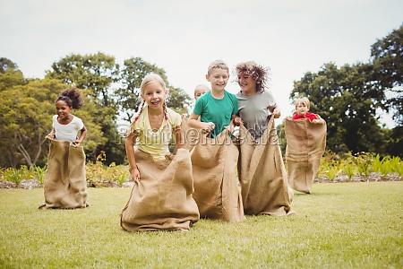 children having a sack race