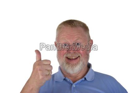 laughing senior holds thumbs up
