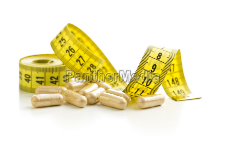 capsules and measuring tape