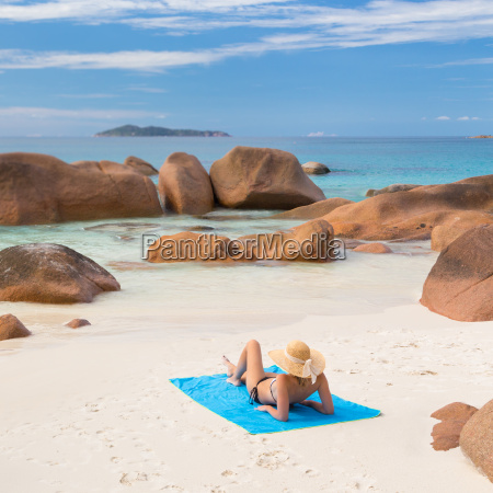 woman sunbathing at anse lazio picture