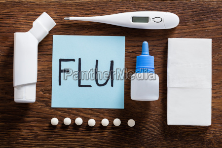 flu concept on wooden desk