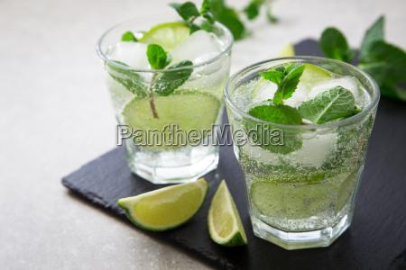 cold refreshing summer lemonade mojito in