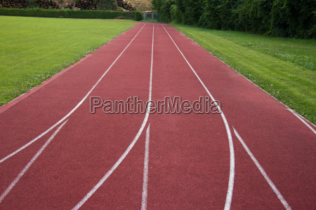sports field with red running track