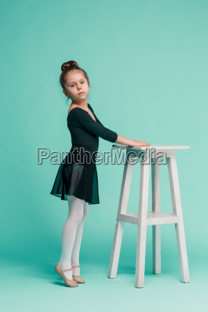the little balerina dancer on blue