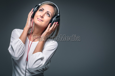pretty young woman listening to her