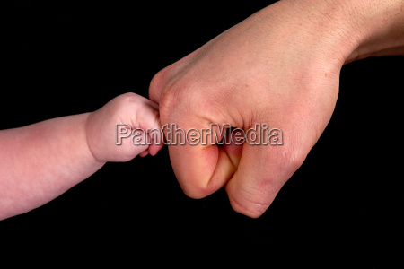 adult baby hand care touch closeup