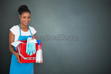 female janitor holding cleaning equipment