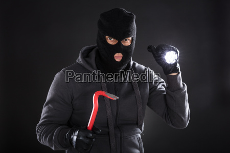 portrait of a burglar on black