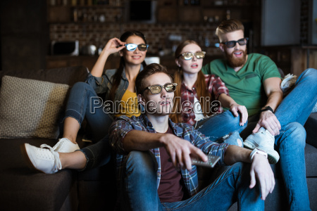 young friends in 3d glasses watching