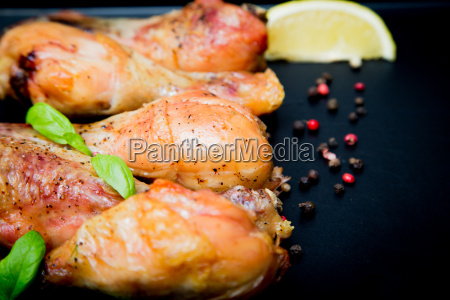 roasted chicken legs with basil on