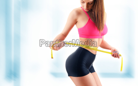 young, woman, measuring, herself., weight, loss - 20376003