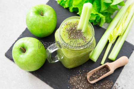 blended green smoothie with ingredients superfood