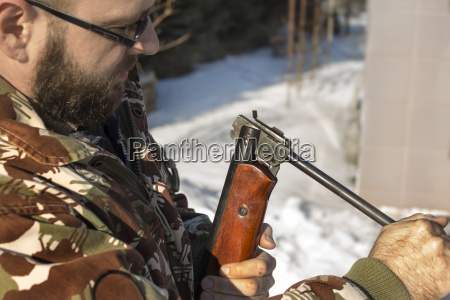 hunter hunting reload firearms in the