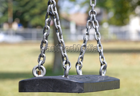 empty chain swing in playground at