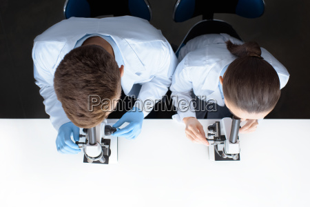 top view of scientists in uniforms