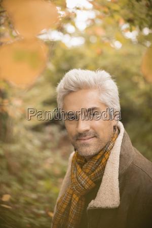 portrait confident man wearing scarf in